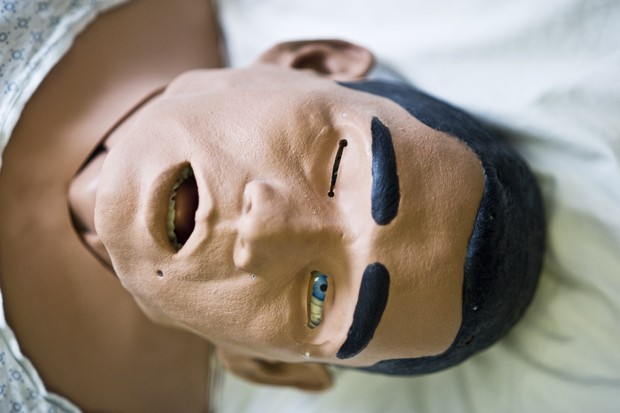 A METI iStan mannequin lies in the SimPORTAL ward of the mayo building on Friday. The METI iStan acts like a real patient with real sounds, bleeding, and even tear ducts for medical students to practice on in a less stressful situation.