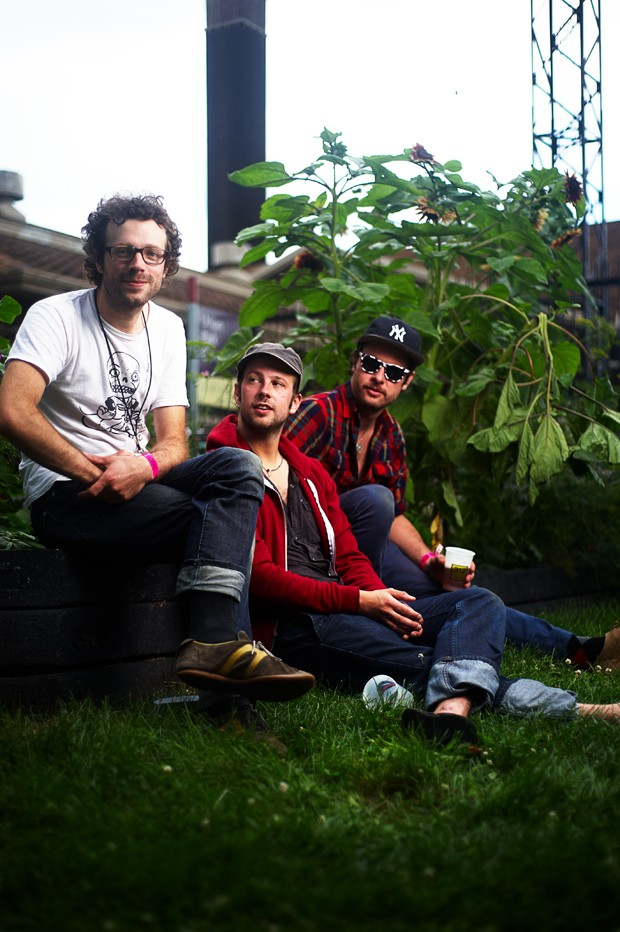 Canadian rockers Plants and Animals enjoying a beer after their Sat. afternoon set.