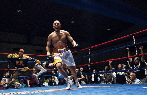 Caleb Truax celebrates after a come-from-behind seventh round technical knockout of New Jersey fighter Patrick Perez on Saturday.