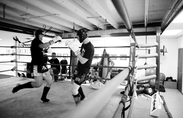 Cellar Kickboxing owners and brothers, Christopher, left, and Jon Cichon spar during a practice on Monday. The Center is moving locations near the University in the fall.