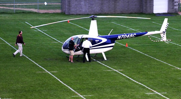University of Minnesota head football coach Tim Brewster prepares to leave Irondale High School Friday.  Brewster chartered a helicopter in order to visit three high school football recruits.