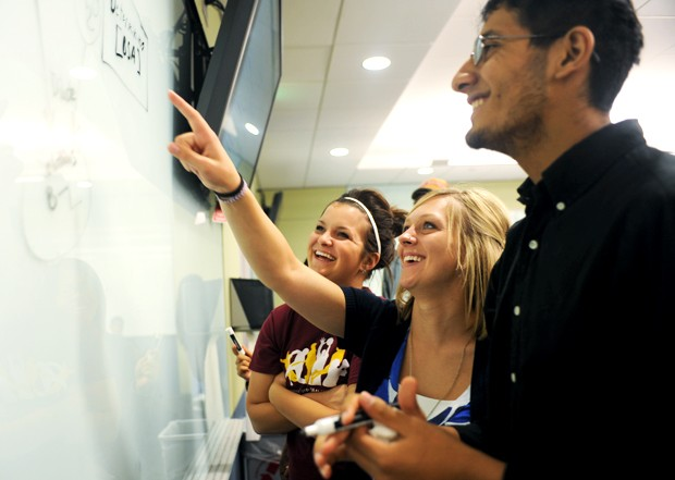 University students Kimberly Reed, left, Gina Robinson-Haase, and Zee Chattha check over a diagram Monday in their Foundations of Biology class. The class is held in an Active Learning Classroom designed to create an interactive and flexible learning space for students through the use of technology.