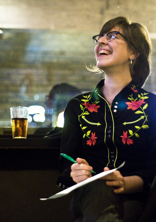 Free Geek Twin Cities co-founder Amanda Luker takes a quiz during the Geekathlon at Grumpy's Grill and Bar on Saturday.