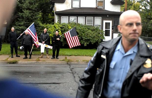 Minneapolis Police monitor white supremacy protesters Saturday outside the YWCA in South Minneapolis.