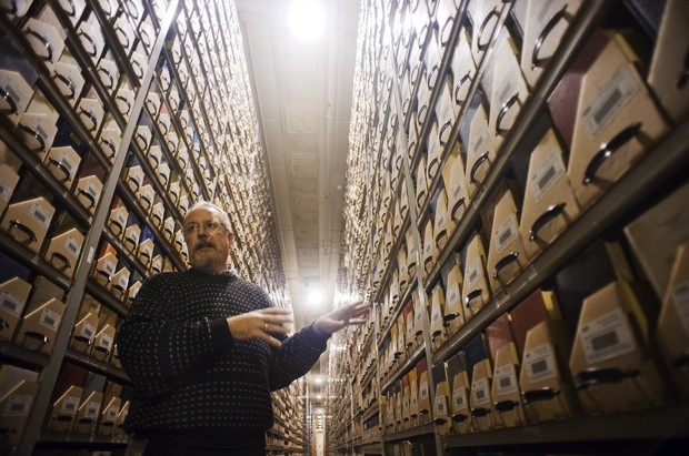Library curator Tim Johnson points out archived books Tuesday in the Elmer L. Andersen Library. Comprised of nearly 3 million volumes, the library is home to one of the world's foremost rare book collections.