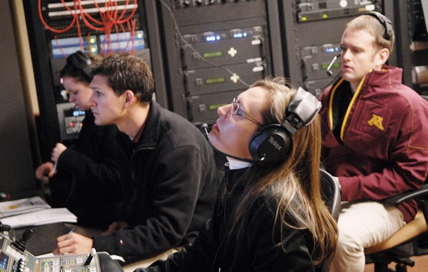 Kari Ahlsterand, center, directs cameras for the big screen at the football game on Saturday.