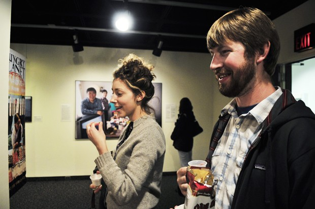 Steve Willis and Georgia Rubenstein eat snacks from around the World at the new Hungry Planet exhibit at the Bell Museum on Thursday.
