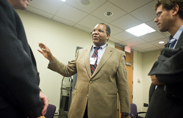 Chief Medical Officer of the American Cancer Society Otis Brawley talks with researchers at the Lillihei Heart Institute on Friday.