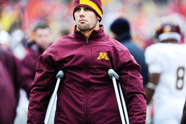 Minnesota senior Eric Decker watches from the sideline during the Gophers 38-7 loss to Ohio State Saturday.