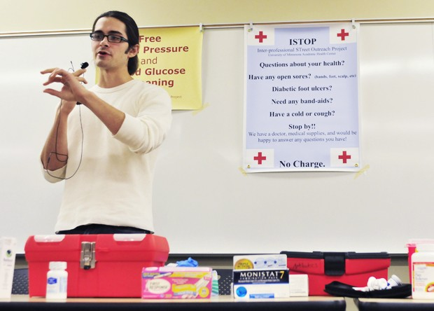 University second-year medical student Jacob Feigal gives a demonstration Monday during a training session for potential ISTOP members.