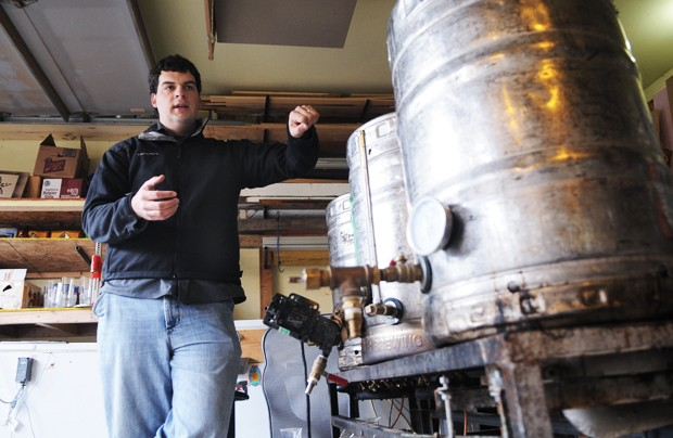 Ryan Petz, a graduate student at the Carlson School of Management, explains the brewing process Monday in his co-worker's garage in Minneapolis. Petz is the co-founder of Fulton Beer and has brews on tap at numerous area bar and restaurants.