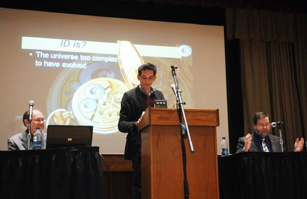 Dr. Jerry Bergma, left, a biology professor at Northwest State College in Ohio, and Dr. Paul Z Myers, right, a biology professor at UMN Morris, debate whether intelligent design should be taught in schools Monday night in the St. Paul Student Center under the moderation of Dr. Mark Borrello, center.