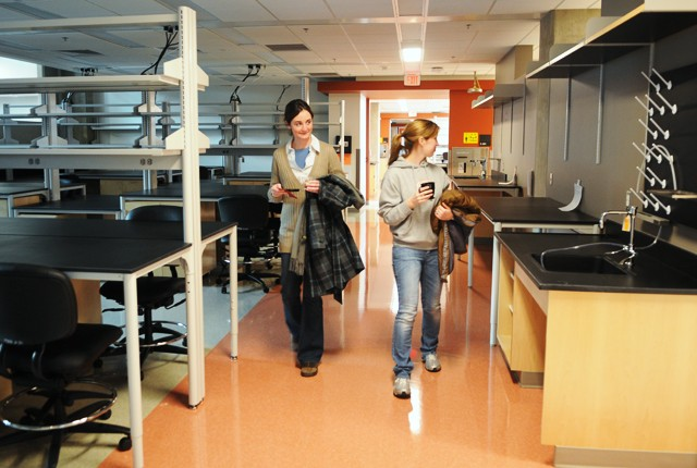 Graduate students Michelle Gleason, left, and Rachelle Veenstra in the Microbiology, Immunology, Cancer Biology doctoral program take a tour of the labs at the grand opening of the Medical Biosciences Building on Monday.