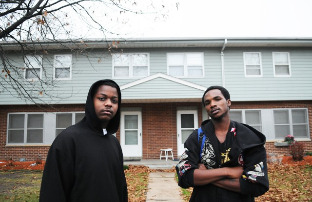 Dominique Smith, left, and Romeal Hughley, right, are residents of the Glendale Housing Complex in Prospect Park.