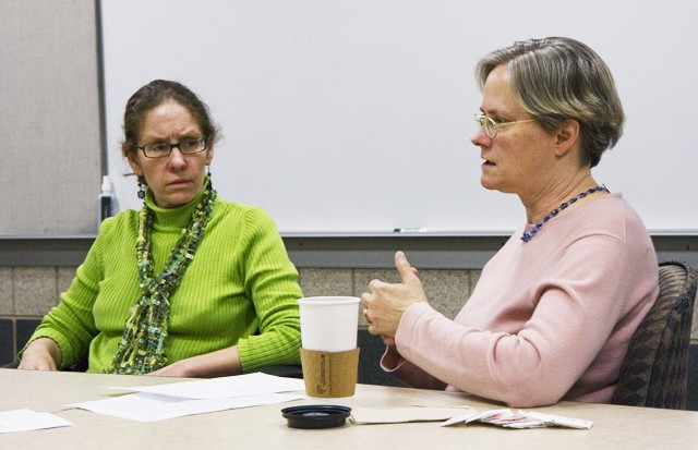 Associate Professor at Humphrey Institute Maria Hanratty, left, and Hennepin County's Office to End Homelessness representative Lisa Thornquist, right, spoke to a group of graduate students Wednesday at Carlson School of Management.