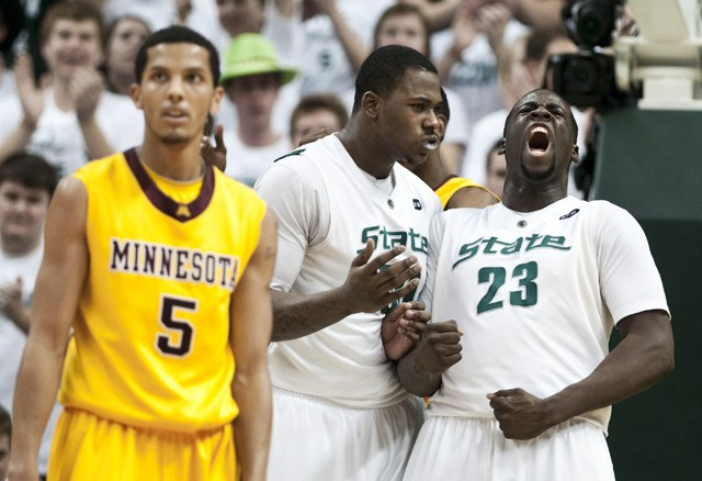 Michigan State forward Draymond Green, far right, celebrates after getting fouled in the first half of a game on Wednesday at Michigan's Breslin Center.