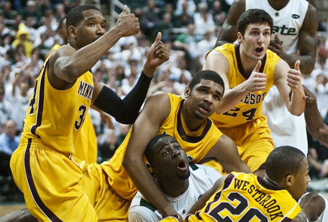 Gopher players scramble to try and force a jump ball while Michigan State tries to call a quick timeout on Wednesday during a game at Breslin Center.