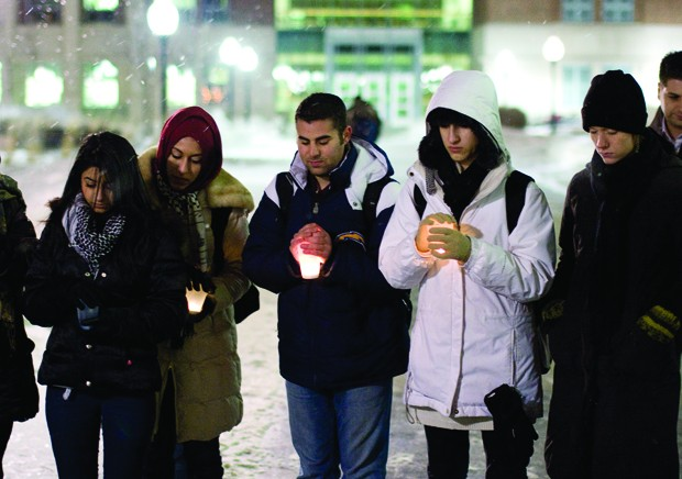Students gather for a candle-lit vigil in front of Coffman Memorial Union on Monday. The demonstration was part of Gaza Week put on by Break the Bonds.