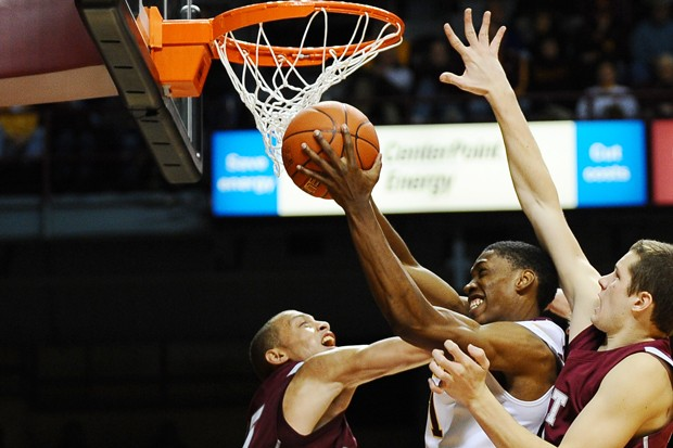 Gophers junior forward Paul Carter goes up for a shot against St. Joseph's at Williams Arena earlier this season. Minnesota won its first 10 home games before falling Saturday to No. 6 Michigan State 65-64.