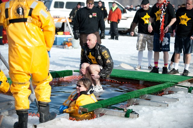 A participant in the Polar Bear Plunge cannonballs Sunday into the waters of White Bear Lake.