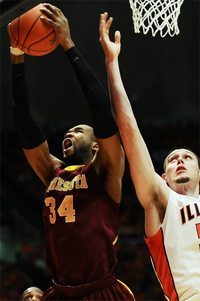 Minnesota forward Damian Johnson (34) grabs a rebound against Illinois forward Mike Tisdale on Saturday at Assembly Hall in Champaign IL.