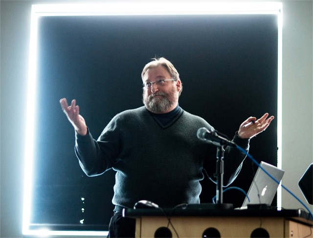 Jeff Crump, a professor of housing studies, presents his project during research slam on Friday in Rapson Hall.