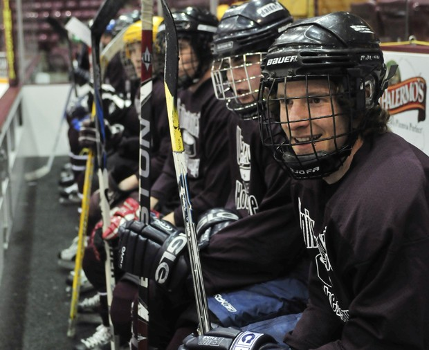 Junior civil engineer Sam Paitich watches his hockey team play on Sunday night at Mariucci Arena. The University Athletic Hockey League (UAHL) is the only full-contract Intramural hockey league in the country.