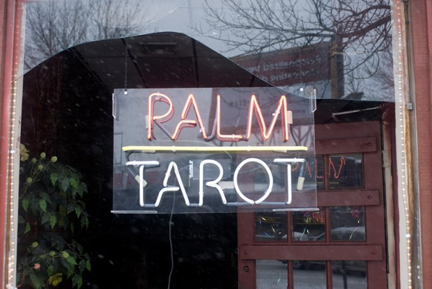 The window of Palm, Tarot and Psychic Readings is broken open on Monday after the storefront was hit by a car.