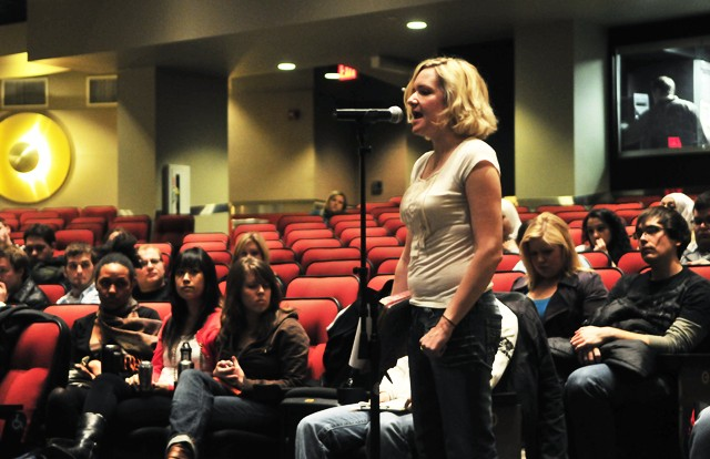 Graduate and Professional Student Assembly President Kristi Kremer speaks to the U of M fees committee at Coffman Union Memorial Hall on Tuesday.  The committee denied GAPSA over $300,000 in funding because they missed an application deadline.