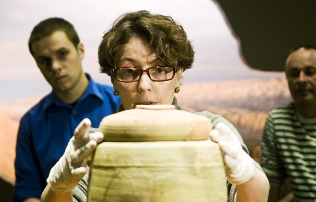 Helena Sokolov centers the lid on the jar Thursday at the Science Museum of Minnesota.