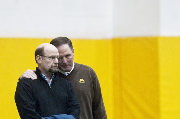 Minnesota Gopher football coach Tim Brewster, right, talks with Vikings head coach Brad Childress on Wednesday during Pro Day.