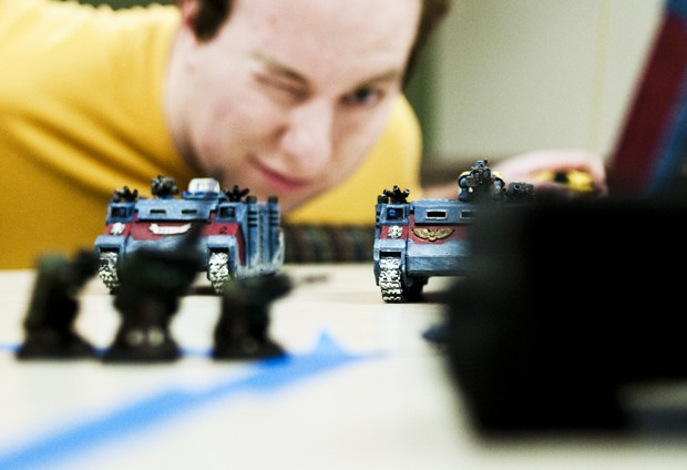 Computer Science senior Stew Wilson checks his line of fire during a game of Warhammer 40,000 on Friday, March 12 at Coffman Union.