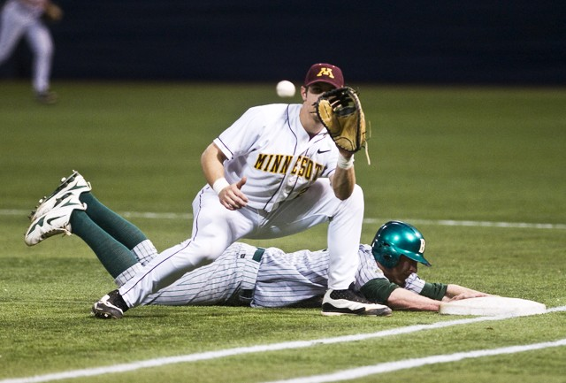 Gophers first baseman Nick O'Shea attempts to tag out Bison's Zach Wentz at first base during a game Tuesday at the Metrodome.