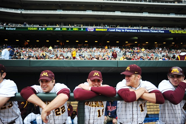 Gophers Trip Schultz, left, Kurt Schlagen, center, and Ryan Abrahamson, right, chat before the first game at Target Field.