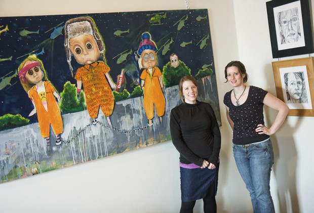 """Artists Kara Hendershot and Summer Scharringhausen stand if front of their panting titled """"Penelope"""" at Altered Esthetics on Tuesday. The new exhibit features collaborative artwork."""