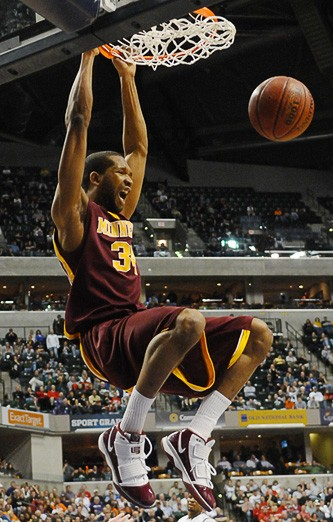 Minnesota forward Damian Johnson dunks the ball late in the second half of the Gophers' overtime upset of Michigan State on Friday night.
