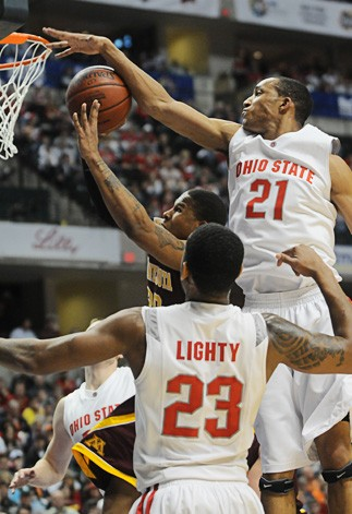 Ohio State's Evan Turner blocks a Lawrence Westbrook shot in the first half of the Gophers' 61-90 Big Ten Tournament championship loss on Sunday.  Turner's top-seeded Ohio team overwhelmed Minnesota by scoring 57 points in the second half.