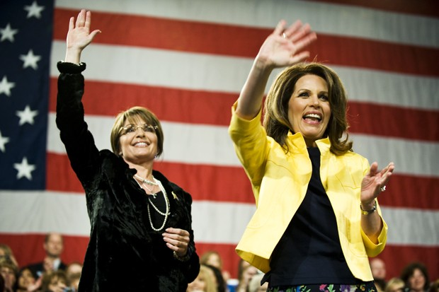 Former Alaska Governor Sarah Palin, left, and Minnesota Representative Michelle Bachman, right, wave to the crowd at the end of their rally on Wednesday at the Minneapolis Convention Center.