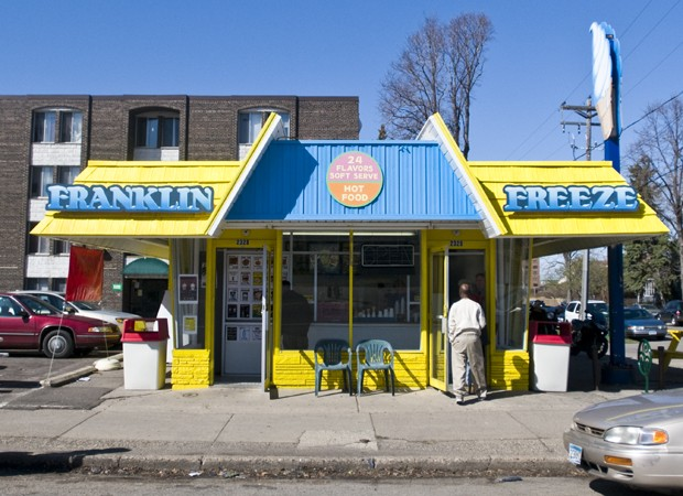 Franklin Freeze owner Scott Tolzmmann serves a cone Wednesday at his ice cream shop.