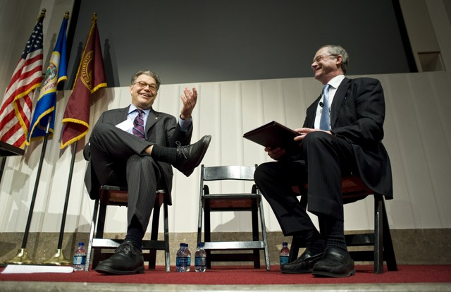 """Senator Al Franken speaks with John Finnegan dean of the School of Public Health about healthcare on Friday in the Mayo Memorial Auditorium. The speech and discussion were part of a roundtable titled """"Health Care Reform: What Just happened."""""""