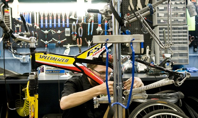 Karl Stoerzinger fixes a bike Tuesday at the Midtown Bike Center.