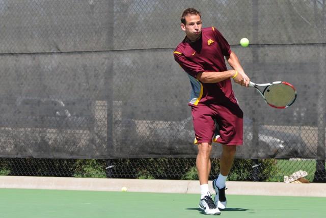 Senior Dino Bilankov plays against Wildcats Andrew McCarthy on Sunday at Baseline Tennis Center.