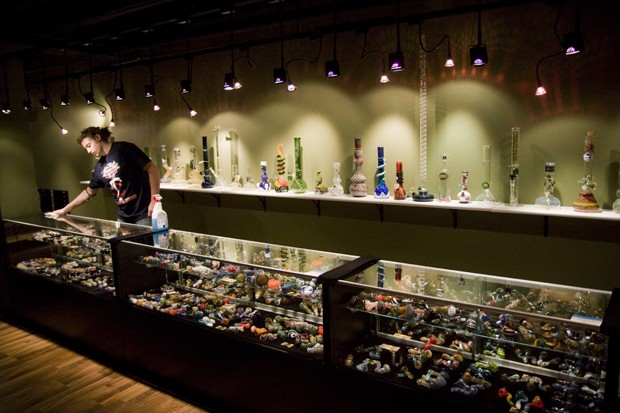 Aaron Becquer, a Junior Marketing Psychology Major at Augsberg   University, cleans a counter at Sherlox Parlour last Monday. Sherlox   Parlour is a new head shop in Dinkytown that features hand blown glass pipes from local artists.