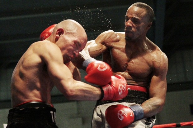 Phil Williams delivers a punch to Caleb Truax Friday at the St. Paul Armory.