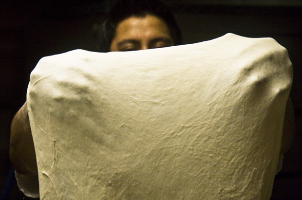 Jocobo Flores prepares pizza dough at Mesa pizza.