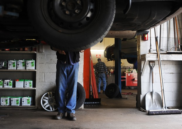 Mechanic Eric Gavic prepares a car for a tire rotation at Como Imports.