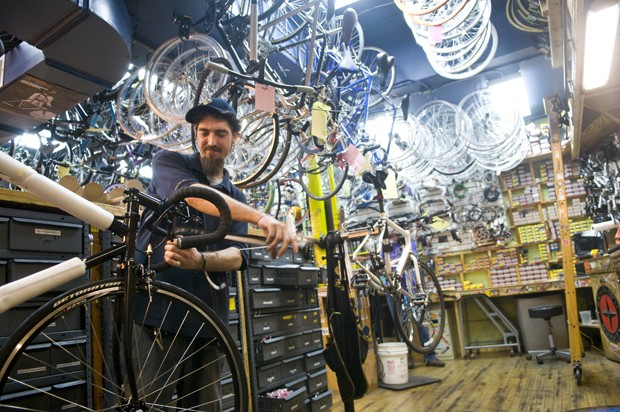 Owner Jameson McGuine works on a bike at the Varsity Bike Shop in Dinkytown.