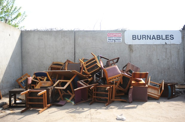 A pile of discarded chairs occupy a corner of the Como Recycling Facility.