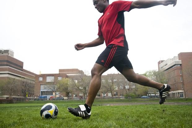 University chemistry engineer junior Hameed Yusuf plays soccer outside the Recreation Center.