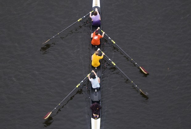 The University rowing team practices on the Mississippi River.